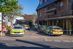 © Licensed to London News Pictures. 22/04/2021. Walton-on-Thames, UK. Police vehicles block an alley way next to an M&S store. Police responded to an incident at 14:15 BST on church Street in Walton-on-Thames, police and forensic investigators could be seen at he scene. Photo credit: Peter Manning/LNP
