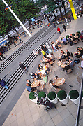 ATBK98 People eating lunch outside Southbank London England