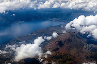 Bali, Bangli, Batur. The Batur volcano and Lake Batur with the Toya Bungkah village just beneath, looking south (from airplane).