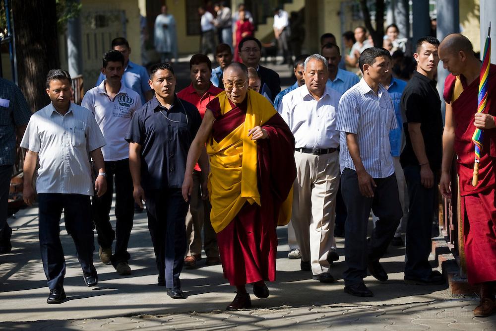 Dalai Lama makes his way toward the temple to attend morning prayer ceremony in Dharamsala, India, May 26, 2009.