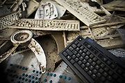 Discarded computer keyboards and parts of other electronics are piled up near the Agbogboloshie market in Accra, Ghana on Tuesday August 12, 2008. The brand name IBM is clearly readable on one of the keyboards.