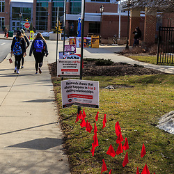 Millersville, PA / USA - February 22, 2016: Students are reminded that if they see red flags in a dating relationship to seek help, at the Millersville University, in Lancaster County, PA