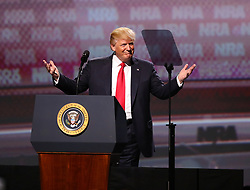 April 28, 2017 - Atlanta, Georgia, U.S.- President DONALD J. TRUMP delivers the keynote at the NRA Leadership Forum on Friday.  Trump is the first sitting president to address the annual meeting in more than 30 years. He reaffirmed his support for gun rights and told NRA attendees that 'the eight-year assault on your Second Amendment freedoms has come to a crashing end.'  (Credit Image: © Curtis Compton/TNS via ZUMA Wire)