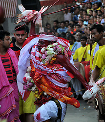 August 19, 2017 - Guwahati, India - A priest performs a dance with a goat during the 3rd day of Deodhani Festival at the Kamakhya Temple in Guwahati on Saturday, August 19, 2017. The festival is held to worship the Serpent Goddess Kamakhya during which goats and pigeons are offered and sacrificed. (Credit Image: © Rajib Jyoti Sarma/Pacific Press via ZUMA Wire)