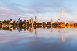 Reflections of Margaret Hunt Hill Bridge and downtown in Trinity River at flood stage, Dallas, Texas, USA
