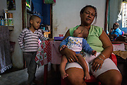 2016/05/26 - Caracas, Venezuela: Loida Teheran, 53, with two of her grandsons, Yalehizer Teharan, 5 months and Yalehiber Teheran, 5, inside her house in 24 de Marzo section of the Petare slum. Loida only eats one meal per day in order to feed the four grandchildren that live with her.(Eduardo Leal)