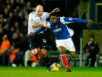 Photo: Gareth Davies.<br />Portsmouth v Everton. The Barclays Premiership. 09/12/2006.<br />Everton's Lee Carsley (L) stops Portsmouth's Manuel Fernandes (R) from chasing the ball.
