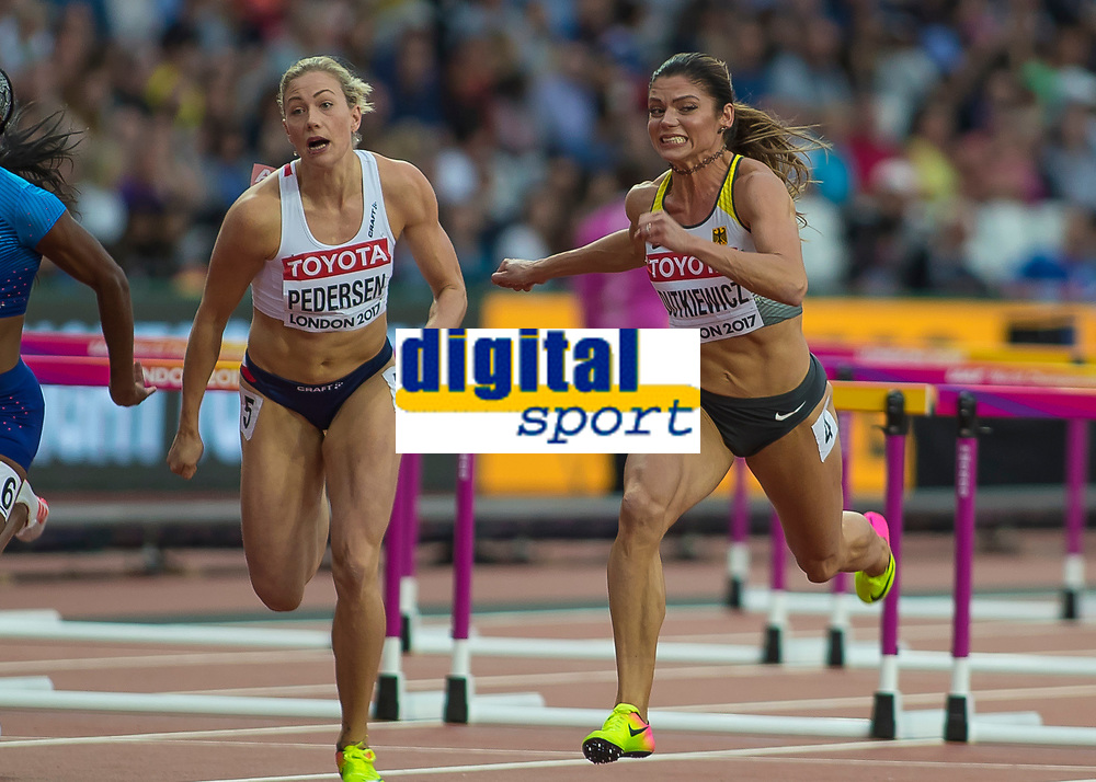 Athletics - 2017 IAAF London World Athletics Championships - Day Eight, Evening Session<br /> <br /> Womens 100m Hurdles Semi final<br /> <br /> Pamela Dutkiewicz (Germany) and Isabelle Pedersen (Norway) compete across the line at the London Stadium<br /> <br /> COLORSPORT/DANIEL BEARHAM