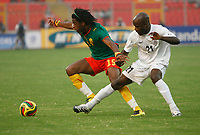 Photo: Steve Bond/Richard Lane Photography.<br /> Cameroun v Zambia. Africa Cup of Nations. 26/01/2008. Alexandre Song (L) keeps the ball despite the close attention of James Chamanga (R)