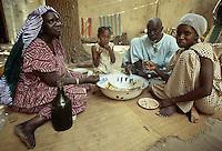 May 1978, Ile de Goree, Senegal --- Family Having a Meal Together --- Image by © Owen Franken