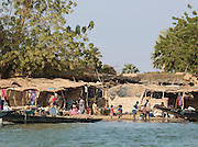 Many people live and go about their daily lives on the banks of the Niger River, at Segou, Mali