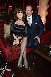 JOAN COLLINS and PERCY GIBSON at a party to celebrate the publication of 'Passion for Life' by Joan Collins held at No41 The Westbury Hotel, Mayfair, London on21st October 2013.