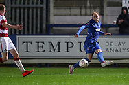 AFC Wimbledon midfielder Mitchell (Mitch) Pinnock (11) crossing the ball during the The FA Cup match between AFC Wimbledon and Doncaster Rovers at the Cherry Red Records Stadium, Kingston, England on 9 November 2019.