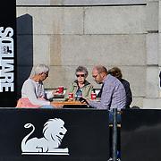 People sitting at Trafalgar cafe in Trafalgar Square, London, UK 24 October 2018
