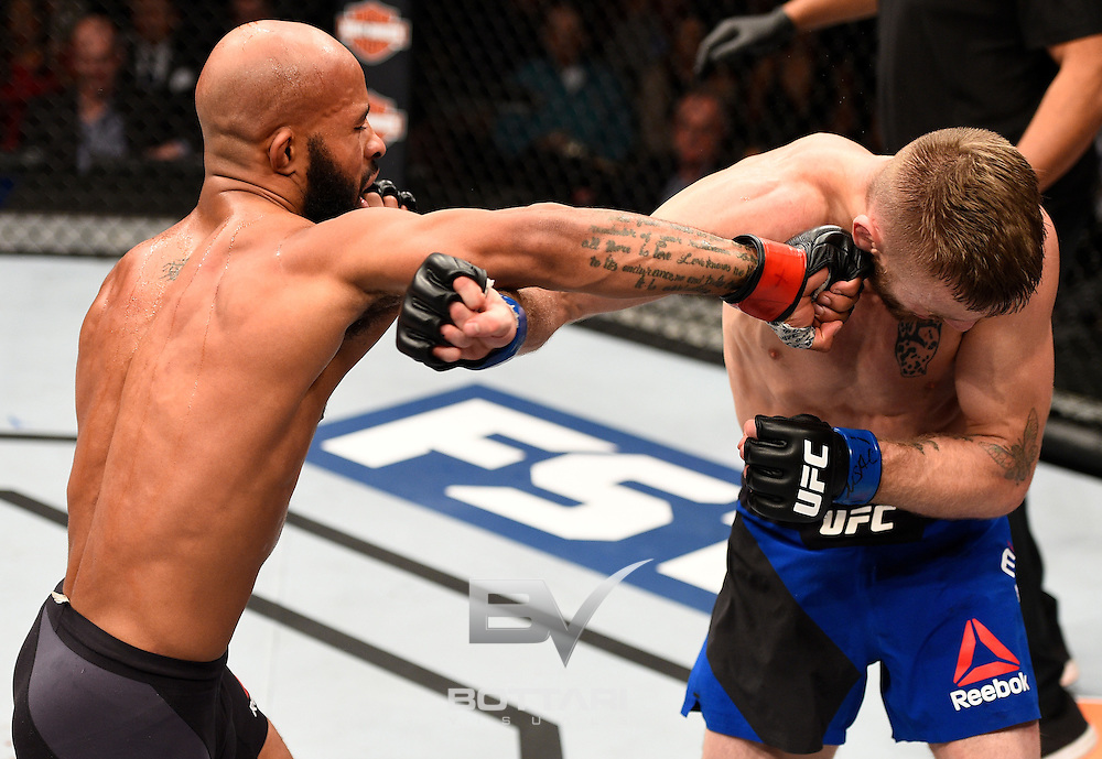 LAS VEGAS, NV - DECEMBER 03:  (L-R) Demetrious Johnson punches Timothy Elliott in their flyweight championship bout during The Ultimate Fighter Finale event inside the Pearl concert theater at the Palms Resort & Casino on December 3, 2016 in Las Vegas, Nevada. (Photo by Jeff Bottari/Zuffa LLC/Zuffa LLC via Getty Images)
