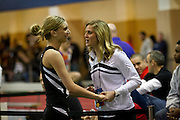 Kayla Ashland of Wisconsin-La Crosse celebrates with her coach after clearing 1.65m during the Women's High Jump competition on Friday at the NCAA Division III Indoor Track and Field National Championships at Grinnell College.