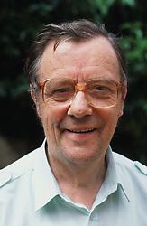 Portrait of elderly man wearing glasses standing outside,