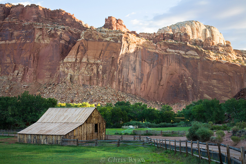 Barn and horse corral beneath cliff faces at Capitol Reef National Park, Utah