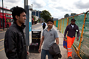 """Two Bangladeshi students in Stratford, East London. Jahanbin Reza, 25 (right) and Shakawoat Hossain Jahid, 22 (left) are bioth accounting students. Both finish their studies in July and are both very worried that there will be no work from them whn they graduate. They will have to leave the country and return home if there is no work. Shakawoat says """"I can stay maybe one more year. We contribute lots of money to the UK economy, so they must think of us"""". This is a relatively poor area of London, but in recent years has seen much regeneration, the construction of a major transport hub and various shopping complexes. Stratford is adjacent to the London Olympic Park and is currently experiencing regeneration and expansion linked to the 2012 Summer Olympics. (Photo by Mike Kemp/For The Washington Post)"""