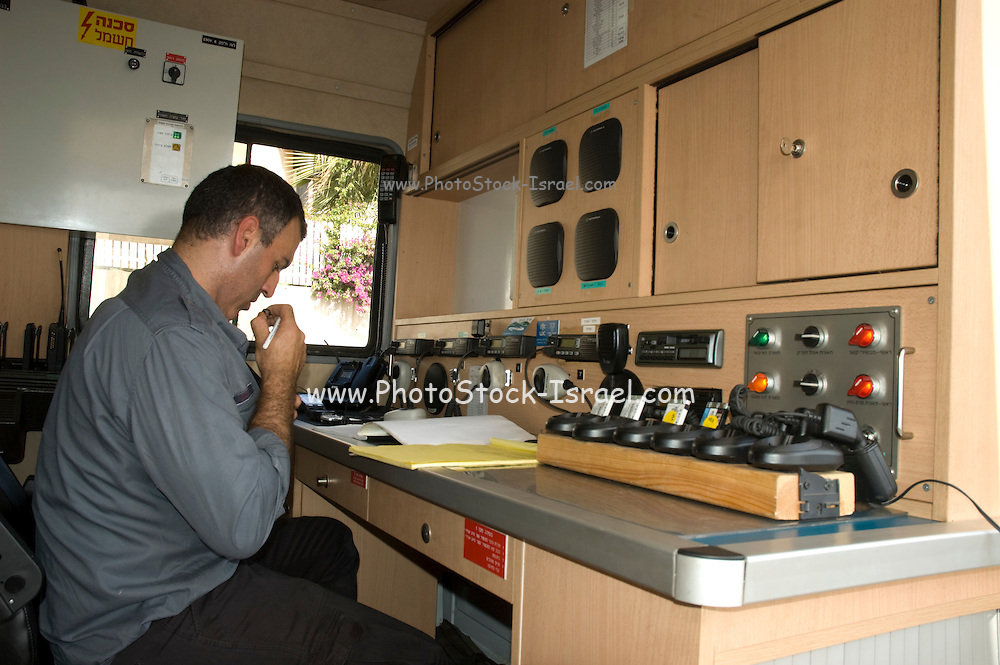 Israel, Haifa Carmel Mountain Forest, Fireman in a mobile command and control vehicle