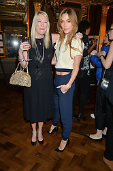 Left to right, CAROLE WHITE and JACQUI AINSLEY at a party to celebrate the publication of 'Have I Said Too Much' by Carole White held at the Cafe Royal, Regents Street, London on 18th February 2015.