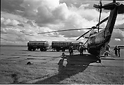 26/06/1963<br /> 06/26/1963<br /> 26 June 1963<br /> Irish Shell and BP fuel tankers for the helicopters of President John F. Kennedy under guard at Dublin Airport. View of one of the helicopters, a U.S. Army  Sikorsky VH-3A Sea King, s/n 150615, being refuelled by a Shell and BP Leyland tanker.
