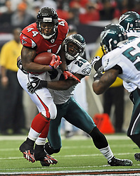 ATLANTA - DECEMBER 6: Running back Jason Snelling #44 of the Atlanta Falcons gets tackled by safety Sean Jones #26 of the Philadelphia Eagles on December 6, 2009 at Georgia Dome in Atlanta, Georgia. The Eagles won 34-7.(Photo by Drew Hallowell/Getty Images)  *** Local Caption *** Jason Snelling;Sean Jones