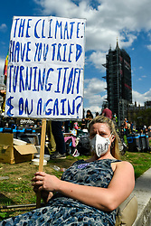 © Licensed to London News Pictures. 01/09/2020. LONDON, UK.  An activist from Extinction Rebellion takes part in a climate change protest in Parliament Square on the day that Members of Parliament return to Westminster after the summer recess.  Photo credit: Stephen Chung/LNP