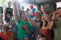 © licensed to London News Pictures. London, UK 22/07/2012. Supporters of Bradley Wiggins celebrating his victory at Look Mum No Hands Cafe in central London. Bradley Wiggins becomes the first British rider to win the Tour de France. Photo credit: Tolga Akmen/LNP
