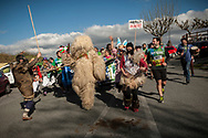"""The bear (an iconic figure of Erratzu carnival) carries the baton as people run on the 20th Korrika. Erratzu (Basque Country) April 3, 2017. The """"Korrika"""" is a relay course, with a wooden baton that passes from hand to hand without interruption, organised every two years in a bid to promote the basque language. The Korrika runs over 11 days and 10 nights, crossing many Basque villages and cities, totalling some 2300 kilometres. Some people consider it an honour to carry the baton with the symbol of the Basques, """"buying"""" kilometres to support Basque language teaching. (Gari Garaialde / Bostok Photo)"""
