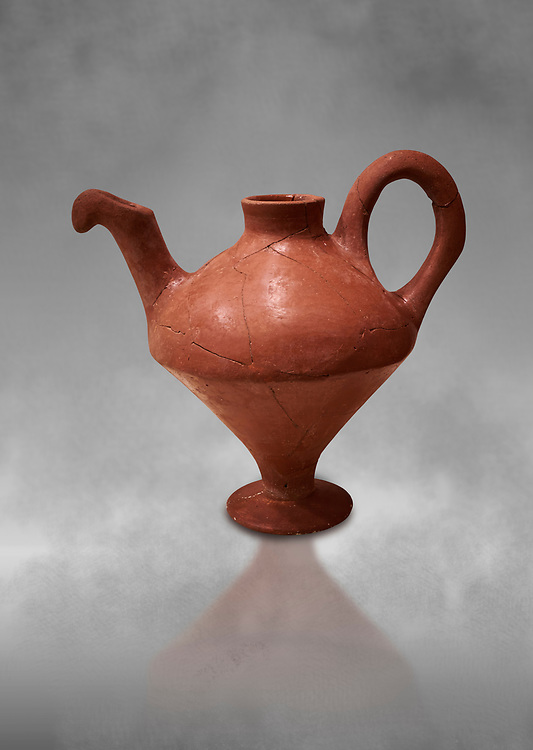 Hittite terra cotta side spouted teapot . Hittite Period, 1600 - 1200 BC.  Hattusa Boğazkale. Çorum Archaeological Museum, Corum, Turkey. Against a grey bacground. .<br />  <br /> If you prefer to buy from our ALAMY STOCK LIBRARY page at https://www.alamy.com/portfolio/paul-williams-funkystock/hittite-art-antiquities.html  - Hattusa into the LOWER SEARCH WITHIN GALLERY box. Refine search by adding background colour, place,etc<br /> <br /> Visit our HITTITE PHOTO COLLECTIONS for more photos to download or buy as wall art prints https://funkystock.photoshelter.com/gallery-collection/The-Hittites-Art-Artefacts-Antiquities-Historic-Sites-Pictures-Images-of/C0000NUBSMhSc3Oo
