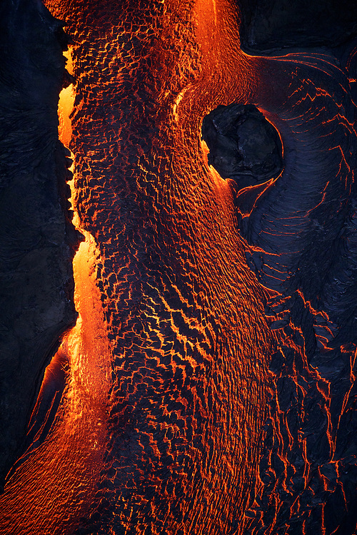 Kilauea's east rift zone: Lava exits fissure 8 via a narrow channel, creating a multitude of textures as it transitions into the perched channel.