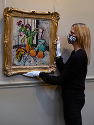 Bonhams picture specialist May Matthews makes the final adjustments to the positioning of Purple Tulips by the Scottish Colourist painter George Leslie Hunter.  It is estimated at £120,000-150,000. <br /> <br /> The painting was once in the collection of Baroness Elliot of Harwood of Rulewater DBE LLD (1903-1994),one of the most colourful, Scottish figures of the last century. One of the first women to be made a Life Peer and the first Life Peeress to speak in the House of Lords, she enjoyed a long and distinguished life of public service. <br /> <br /> Hunter was a well-known landscape and portrait painter when, during the1920s, his friend and biographer Tom Honeyman encouraged him to concentrate on painting still-life. In 1925, Alex Reid Gallery held a critically acclaimed exhibition of Hunter's work, and in the same year, the artist exhibited in London alongside the other painters – Peploe, Fergusson, and Cadell – who later became known collectively known as the Scottish Colourists.