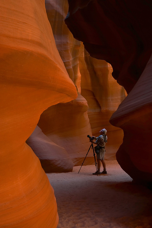 Photographer with a tripod in Antelope Canyon, part of the Navajo Nation, Page, Arizona