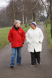 Two women walking in park chatting. Cleared for Mental Health issues.