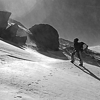 Roger Schley crosses Isoscoles Pass west of Mount North Palisade in Kings Canyon National Park, California. January 1974.