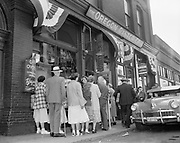 Y-510608-D51. people standing in line to get into Dan & Louie's Oregon Oyster Bar at the corner of SW Ankeny & 2nd.