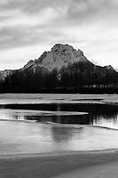 The Tetons and Oxbow Bend glow at sunset in Grand Teton National Park, Jackson Hole, Wyoming.