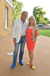 ROD WESTON and PATTIE BOYD at a summer drinks party hosted by Bec Astley Clarke at the Serpentine Sackler Gallery, Hyde Park, London on 17th June 2014.
