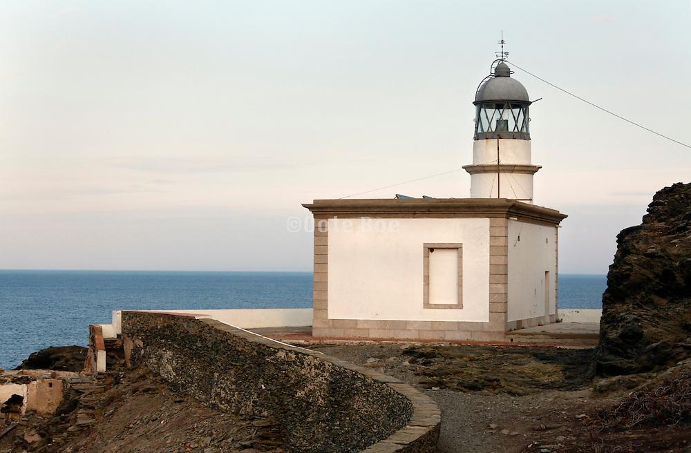 Mediterranean sea coast lighthouse at Cadaques Spain