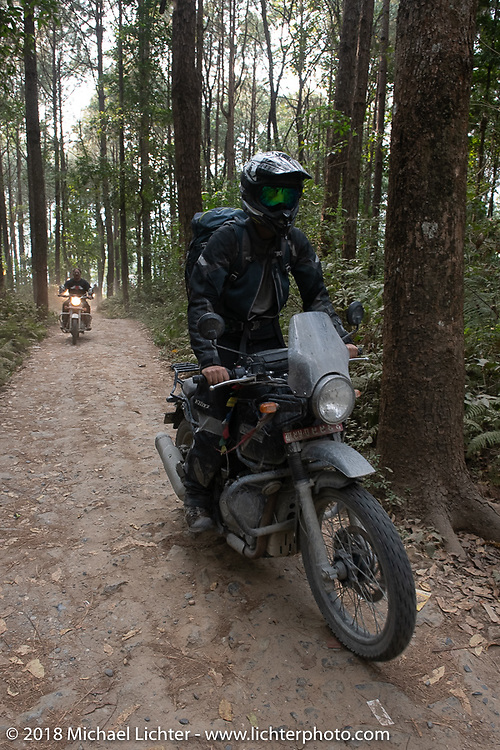Sean Lichter riding out through the forest from the Kusma Gyadi Bridge on Day-7 of our Himalayan Heroes adventure riding from Tatopani to Pokhara, Nepal. Monday, November 12, 2018. Photography ©2018 Michael Lichter.