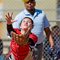 032213       Brian Leddy<br /> Grants Pirate Sabrina Chavez (20) chases down a foul ball at home plate during Friday's tournament game in Grants against Wingate.