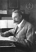 Edward Elgar (1857-1934)  English composer. Elgar at his desk.