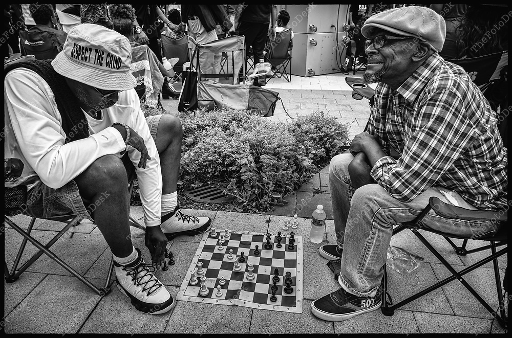 NEWARK, NEW JERSEY: Men play a game of chess during the Bang The Drum House Music celebration of a day in the park  at Mulberry Commons in in Newark, NJ on Sunday, August 29, 2021. (Brian B Price/TheFotodesk).