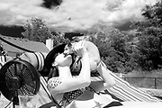 Sharon Grabelle and Lucky kissing on the deck