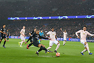 Kylian Mbappe of Paris Saint-Germain crosses for Juan Bernat of Paris Saint-Germain (not in picture) to score 1-1 during the Champions League Round of 16 2nd leg match between Paris Saint-Germain and Manchester United at Parc des Princes, Paris, France on 6 March 2019.