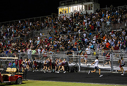 August 18, 2018 - Wellington, Florida, U.S. - Gunfire sent players and fans screaming and stampeding in panic during the fourth quarter of the game at Palm Beach Central High School in Wellington, Florida on August 17, 2018.Two adults were shot Friday night at a football game between Palm Beach Central and William T. Dwyer high schools, authorities said. (Credit Image: © Allen Eyestone/The Palm Beach Post via ZUMA Wire)
