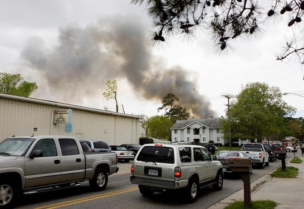 April 06, 2012; Virginia Beach, VA, USA; Smoke comes from the scene of a F-18 crash in Virginia Beach. Mandatory Credit: Peter J. Casey