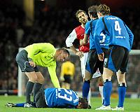 Photo: Ed Godden.<br /> Arsenal v Hamburg. UEFA Champions League, Group G. 21/11/2006. Arsenal's Mathieu Flamini is approached by Hamburg players after his tackle on Rafael Van Der Vaart.