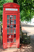 A red phone box along the New King's Road in Parsons Green, London SW6